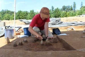 Staff Archaeologist excavates a structure at the Catawba Meadows site.